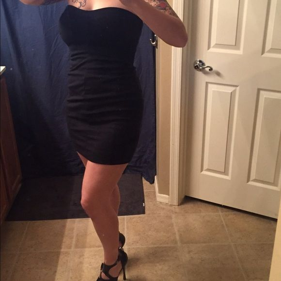 """BR black strapless dress Size 4P. I'm 5'7"""" for reference. LBD. Small slit in back, perfect for when you need to walk . Very form fitting with some stretch. No built in bra, but is lined. Gorgeous dress! EUC. Banana Republic Dresses Mini"""