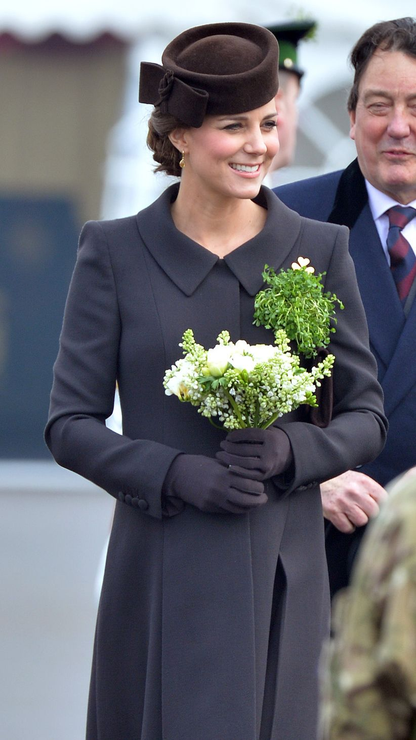 March 2015   Kate smiles, holding a pretty green and white bouquet of flowers. via @stylelist