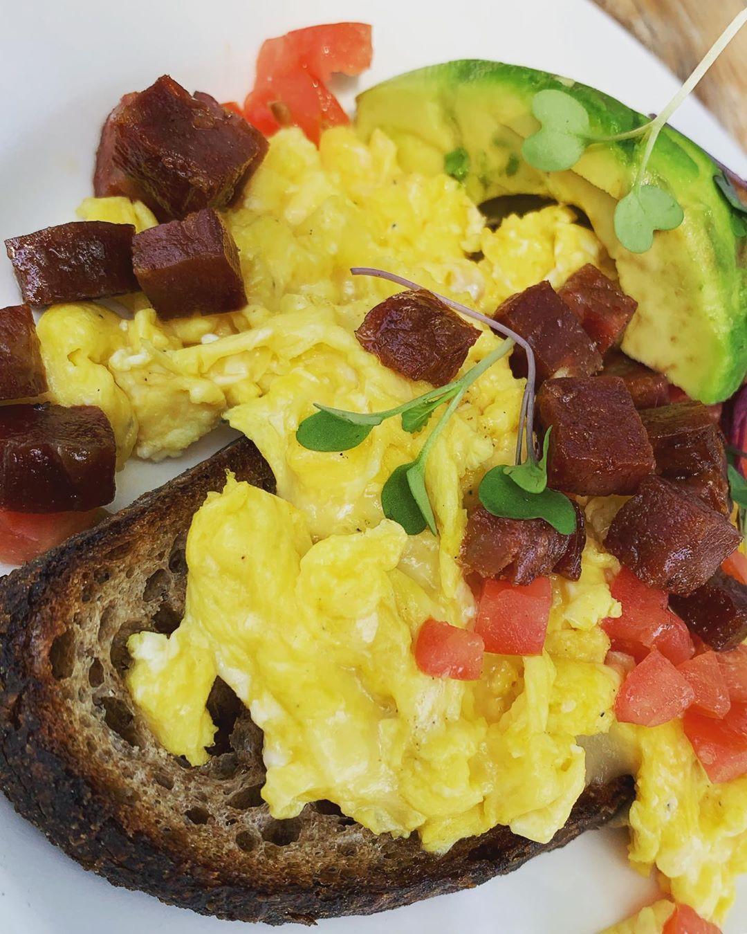 Brunch food is the best food . Fumbally Toast | eggs, scrambled | chorizo | tomato | avocado | micro greens 🌱 @fellowscafe . . .