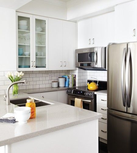 A Compact Condo With Genius Storage Ideas  Grey Small Kitchens Prepossessing Kitchens With Grey Cabinets Inspiration Design