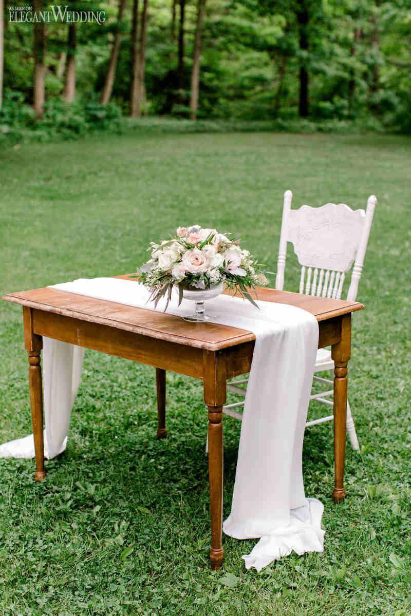 A Boho Wedding Featuring A Triangle Arch Elegantwedding Ca In 2020 Vintage Wedding Ceremony Signing Table Wedding Boho Wedding Ceremony