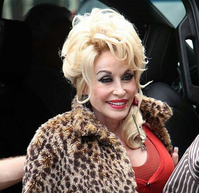 Dolly as the town tramp in the new movie coming out this Christmas ...