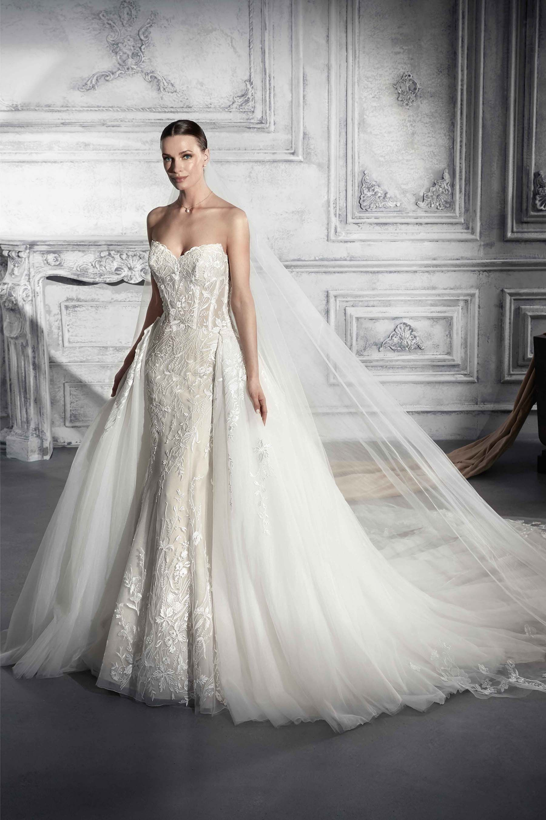 2083a0bd2f49 Demetrios 2018 Style 773 Allover lace embroidered Tulle gown with removable  overskirt. Available in  white