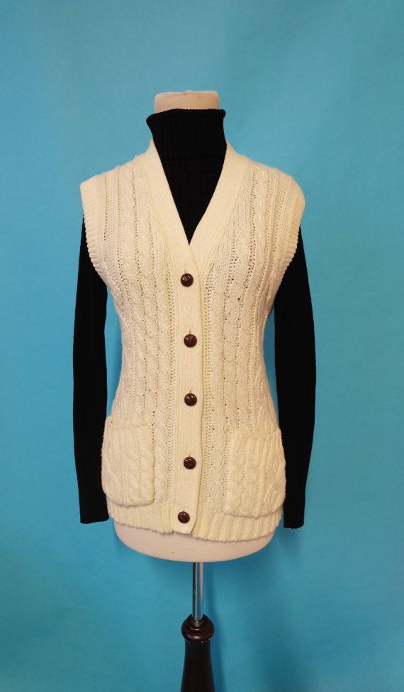 Check out this item in my Etsy shop https://www.etsy.com/listing/491797939/1970s-sweater-cardigan-cardi-top-sweater