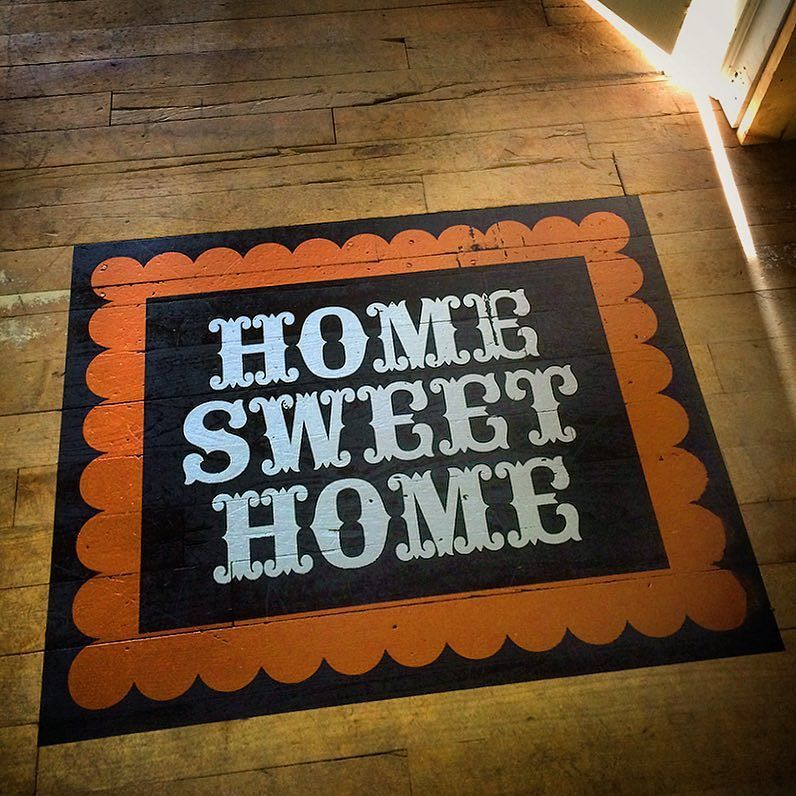 3 color welcome mat at the House Ind. print studio in cozy Grand Rapids Michigan. by houseindustries