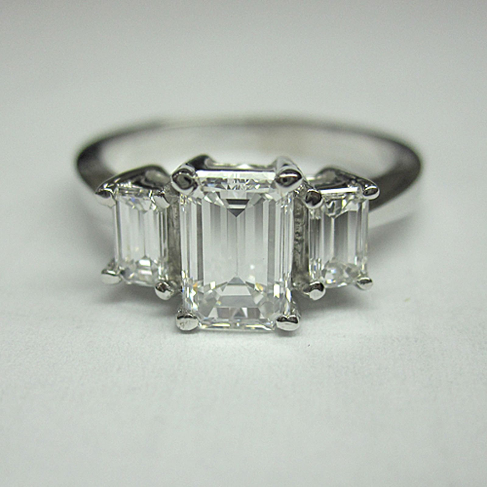 emerald cut 3 stone man made