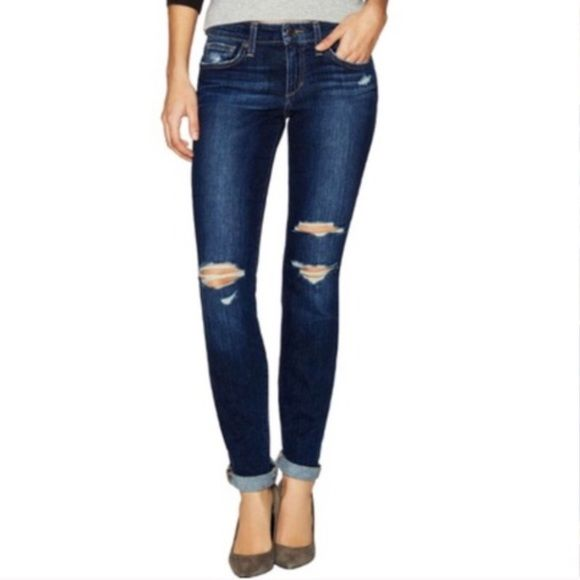 """Size 26 joes jeans the skinny distressed I'm modeling the sz 27 but this listing is for size ✨26!✨     Joes Jeans - the skinny - distressed - NWT - retail $180 sold out in stores - great to wear casual with a big cuff or cuff twice as shown for a polished look with heels.  Please note I'm 5'5 with short legs.  32"""" measured inseam 10"""" rise 10"""" leg openings.  Photographed in daylight in a gorgeous blue VIDIKA wash with shown distress in a soft cotton blend. Joe's Jeans Jeans Skinny"""