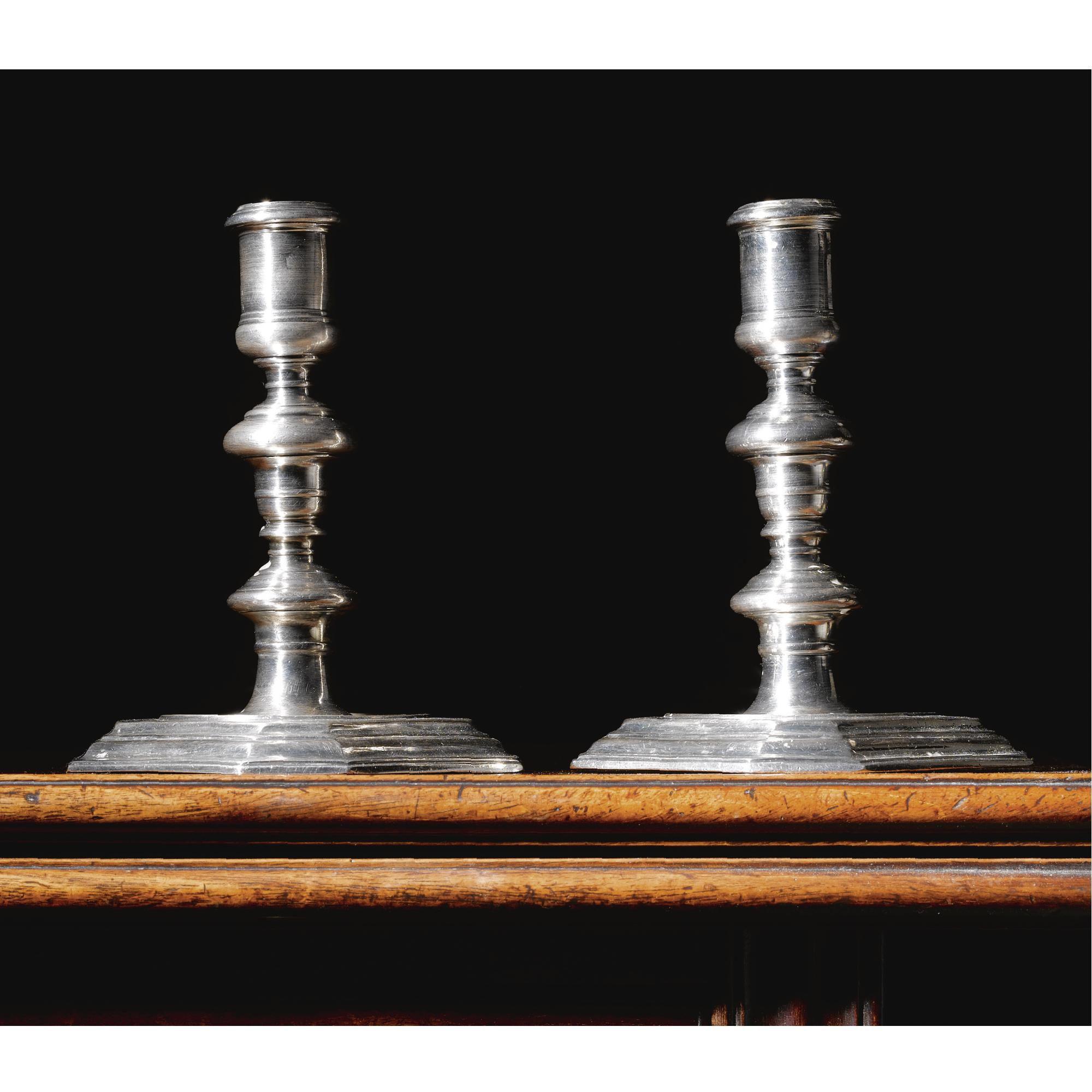 A fine pair of William III Britannia standard silver candlesticks, Pierre Harache I, A French Huguenot refugee  London, 1698