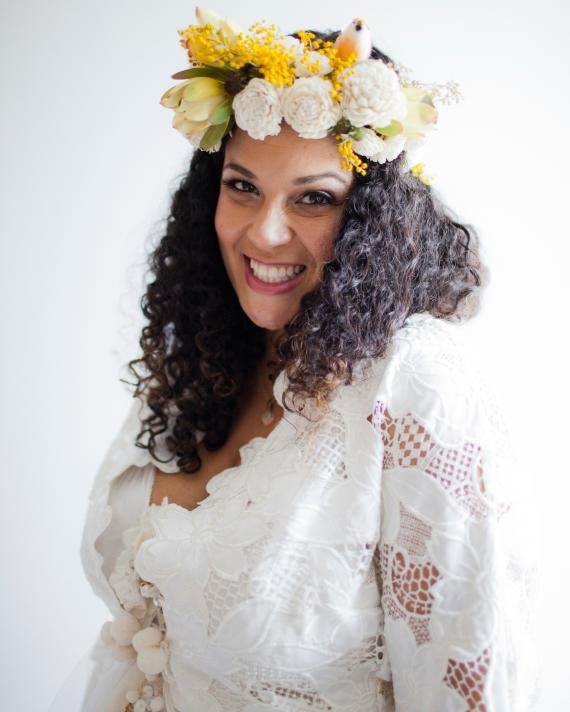 To accent her curly hair, stylist Britni Wood created this bride's floral headpiece of balsa wood flowers, acacia, leucadendron, wax flower, and seeded eucalyptus. A small faux bird was the finishing touch.