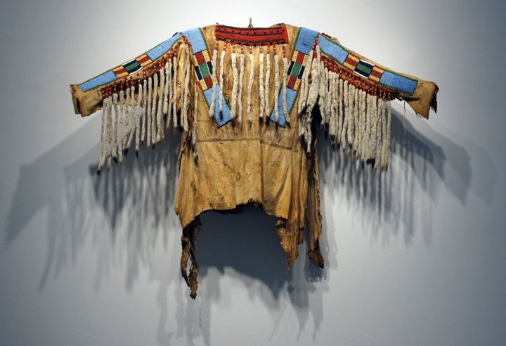"""""""Crow Beaded Hide War Shirt,"""" Nez Perce, width across the sleeves, 54 inches"""