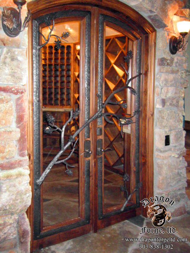 Wine Cellar Door Featuring Pine Cones
