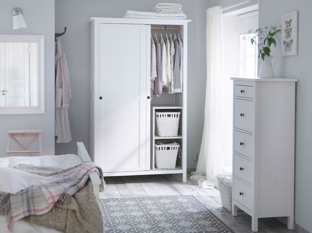A traditional white bedroom with HEMNES wardrobe and chest of