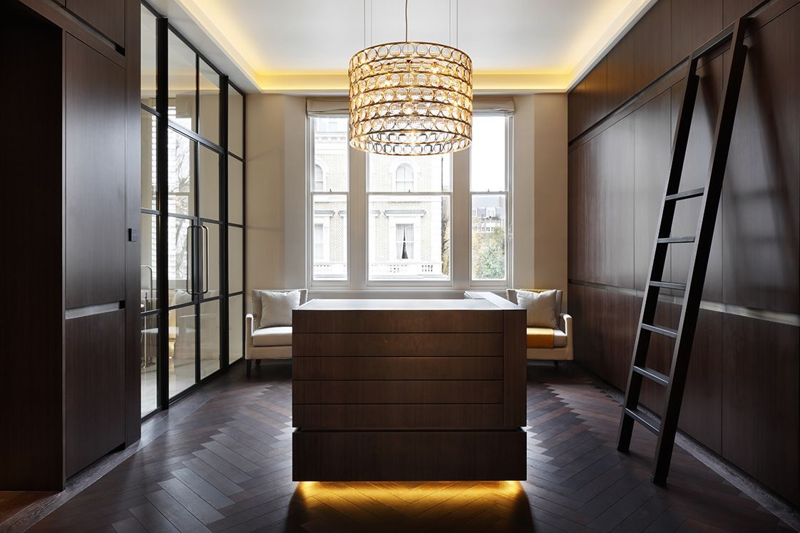 Master Dressing Room With Bespoke Sliding Ladder System And Island Unit  With Metal Trims And Leather
