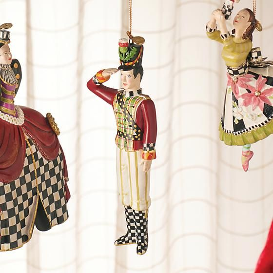 The Nutcracker Ornament - Soldier: If only Tchaikovsky had a costume designer as fanciful as MacKenzie-Childs. Our Nutcracker Ornament Collection breathes new life into the beloved classic by dressing Clara and company in our signature elements from the Soldier's thistle chapeau to the Mouse King's Courtly Check® ascot. This dream of a collection makes the perfect gift for a fan. Hang one from each chair for a holiday fete worth dancing about.