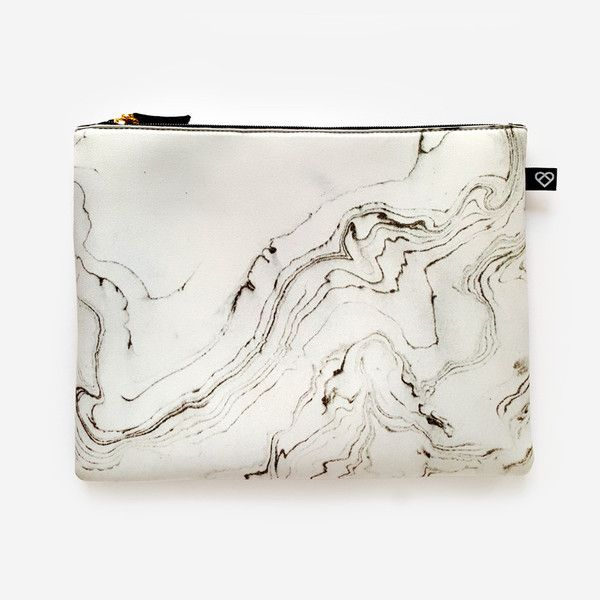 A white marble print neoprene pouch, for the eternal minimalist.Perfect for carrying toiletries, makeup or art supplies. Comfortably fits your iPad with cover. Fabric:NeopreneZip closure. Lined. Fits an iPad with cover comfortably. Dimensions: 23 x 29cm