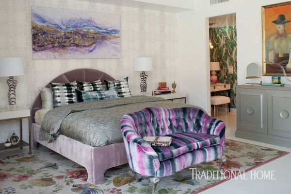 Bold bursts of violet, navy, and fuchsia dazzle in the master bedroom. - Photo: Michael Garland / Design: Julia Buckingham