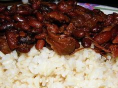 beans and rice with ham hocks... My better half is Puerto Rican and ive tried a bunch of diff recipes for red beans and this one is his fave so far! ;)