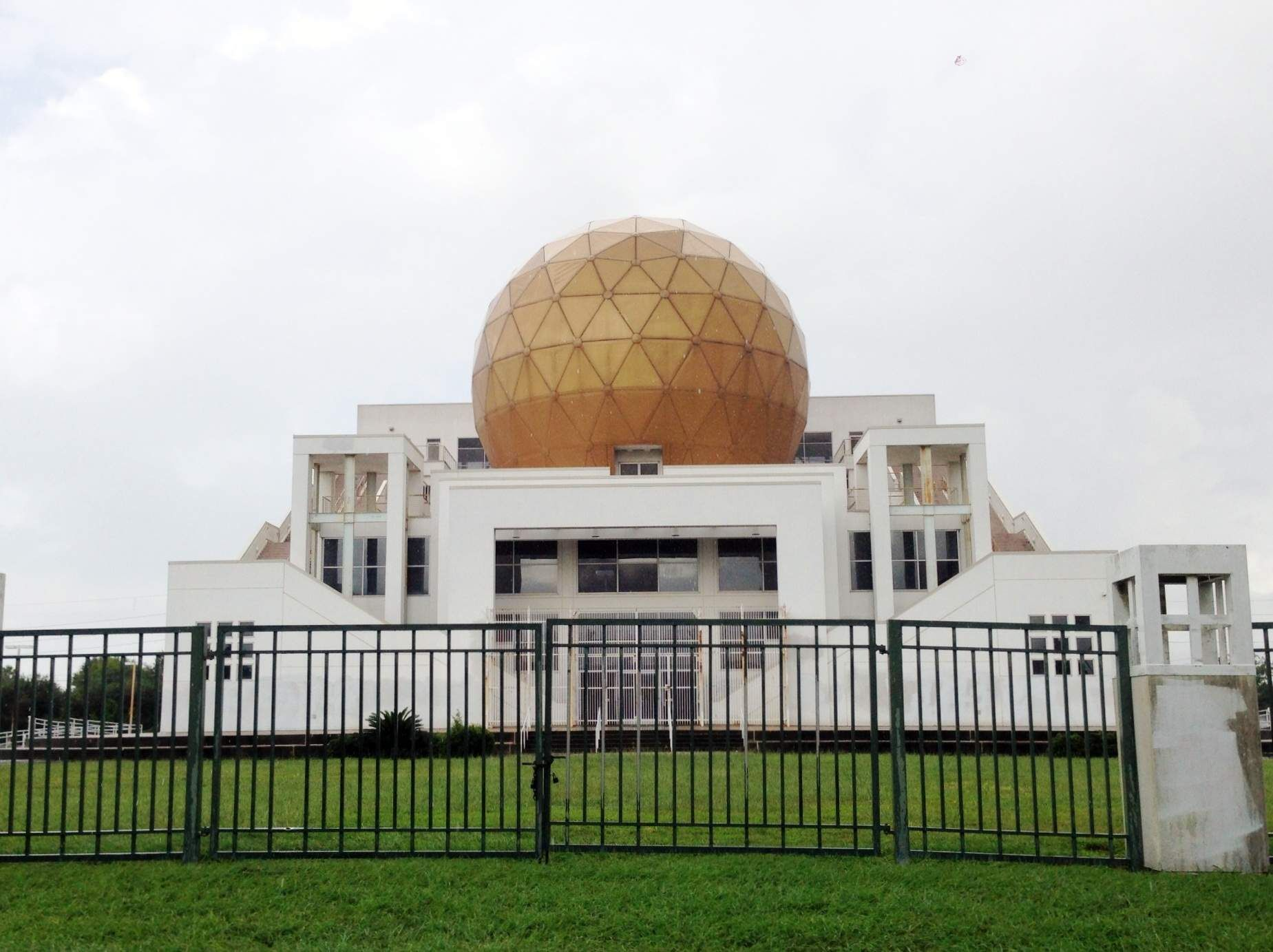 Houston-abandoned palace in the middle of a neighborhood on Ashford Point. With a 40ft gold dome, the unfinished and abondoned Chong Hua Sheng Mu Holy Palace is one of the more bizarre things in Houston (and we have The Orange Show). Also known as the Palace of the Golden Orbs, the $6 million fortress was built by members of a Chinese universalist religious organization that had plans to complete the temple complex before the sect's leader was deported in 1999.