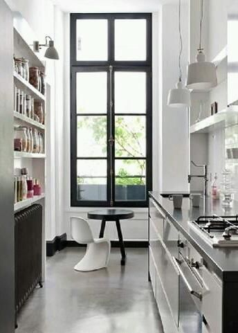 Black Windowsill In A Galley Kitchen