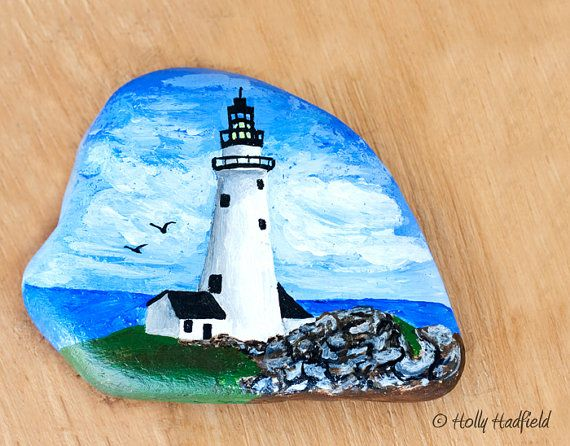 Hand painted with bright acrylic paint. This is the Boston Lighthouse with the ocean and clouds as a backdrop. Painted on Massachusetts beach rock.
