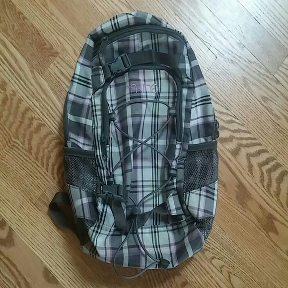 DAKINE small backpack Preloved and in excellent condition. I loved using for day hikes with my daughter. Enough room for snacks, her spare clothes, diaper, etc and water bottle holder on each side. Straps adjust and buckle in front kept it in place while walking around and bending over to help her. Would also be perfect for school aged girls backpack since its not full size. The plaid purple/gray combo make this cute and sporty. Dakine Bags Backpacks