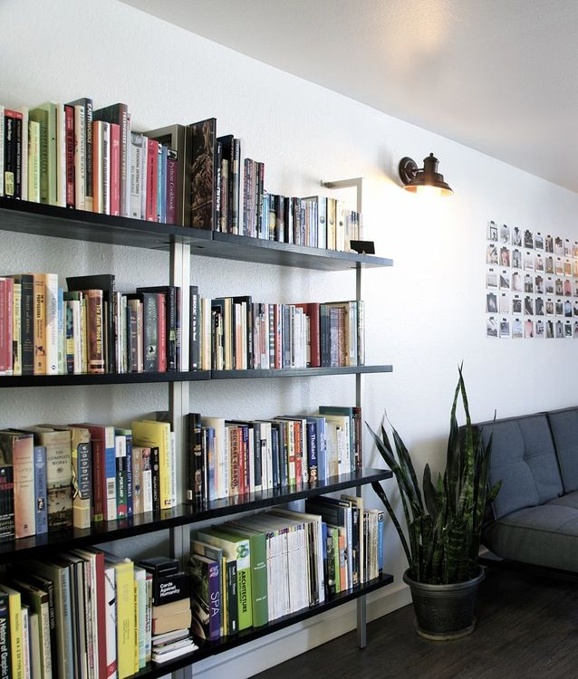 CB2 Helix Bookshelves Actually Holding Books