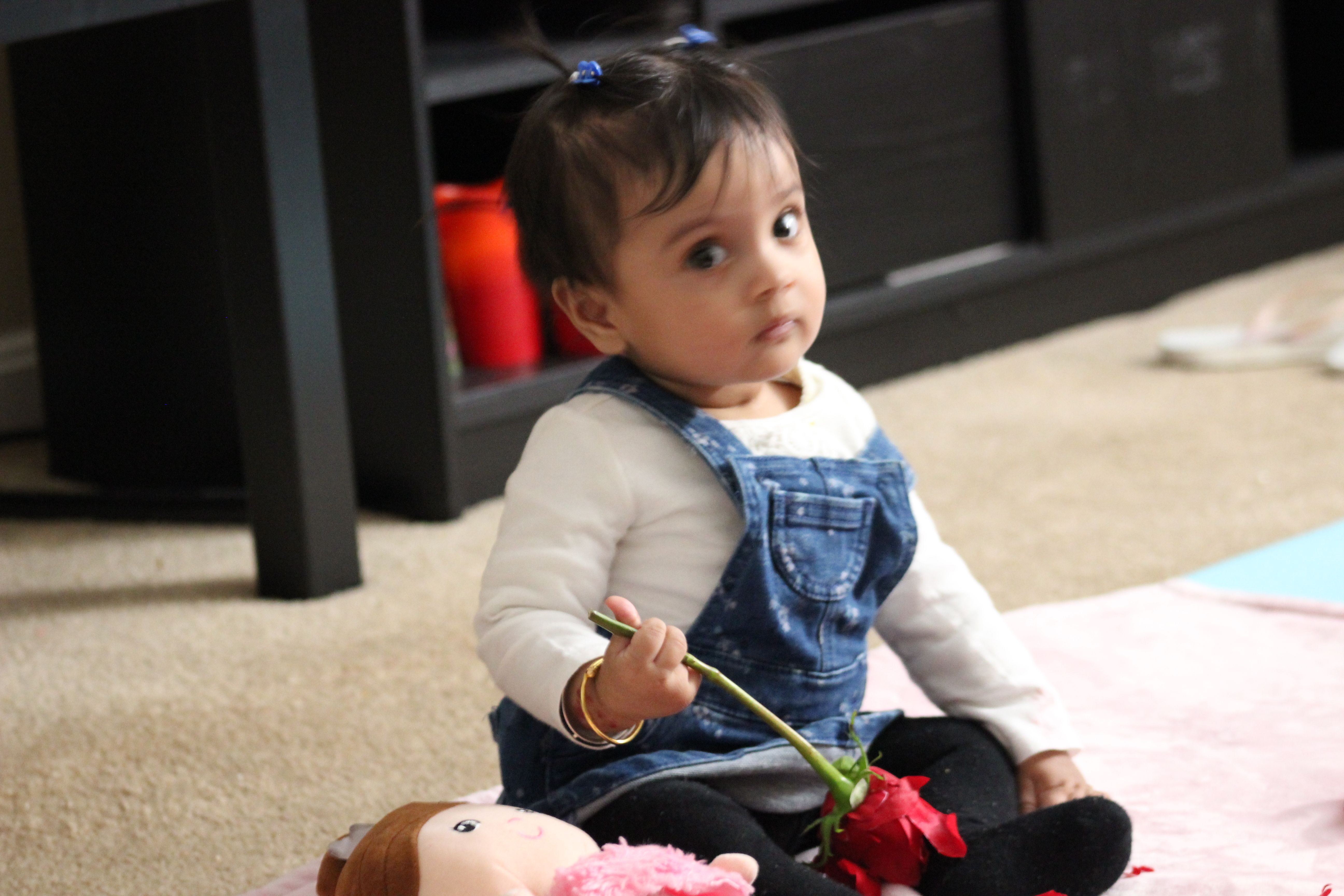 8 months old Baby Girl is little busy in giving out some ...