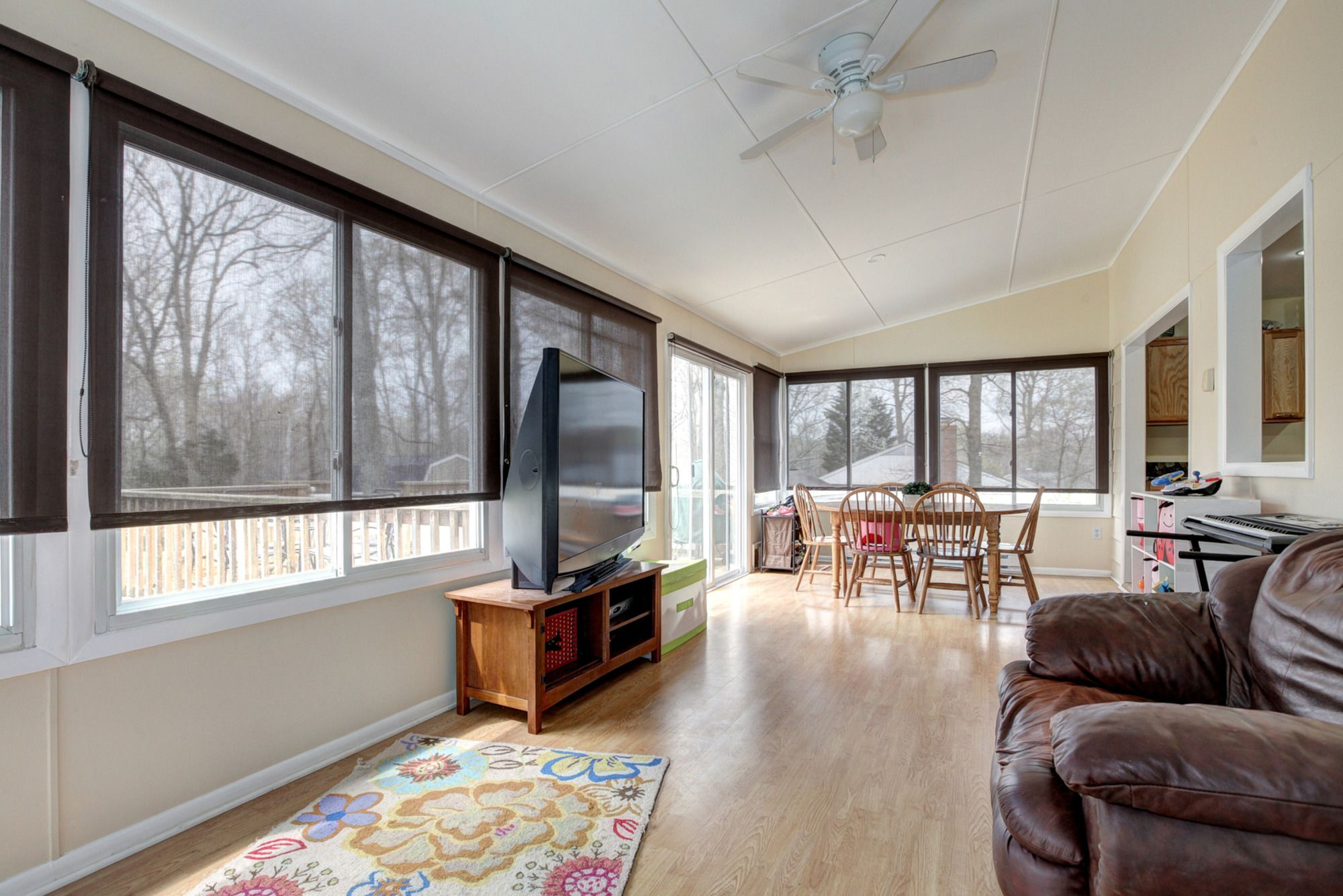 Gorgeous sunroom overlooking all the activity that happens in the backyard. Hardwoods throughout.