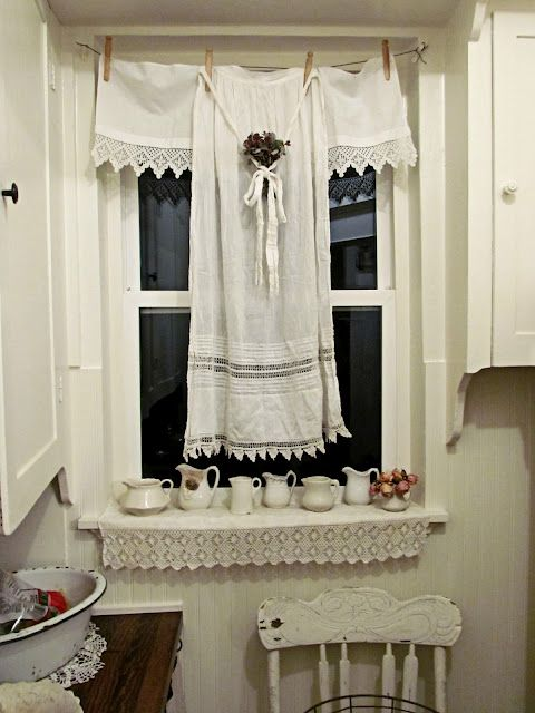 .For laundry room... clothes pins holding old apron or vintage linens as a curtain