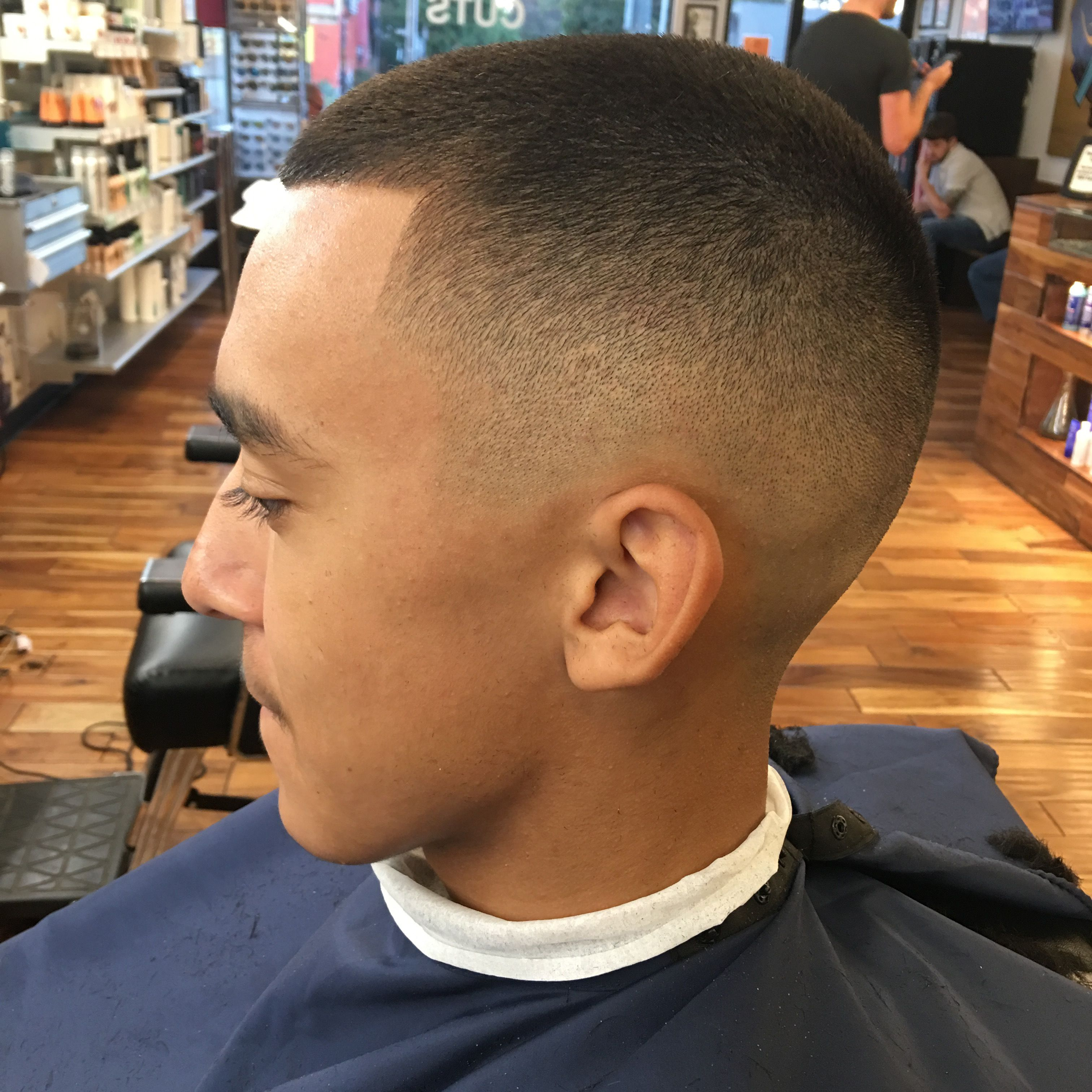 this is a high skin fade with a number two blade on top. on http