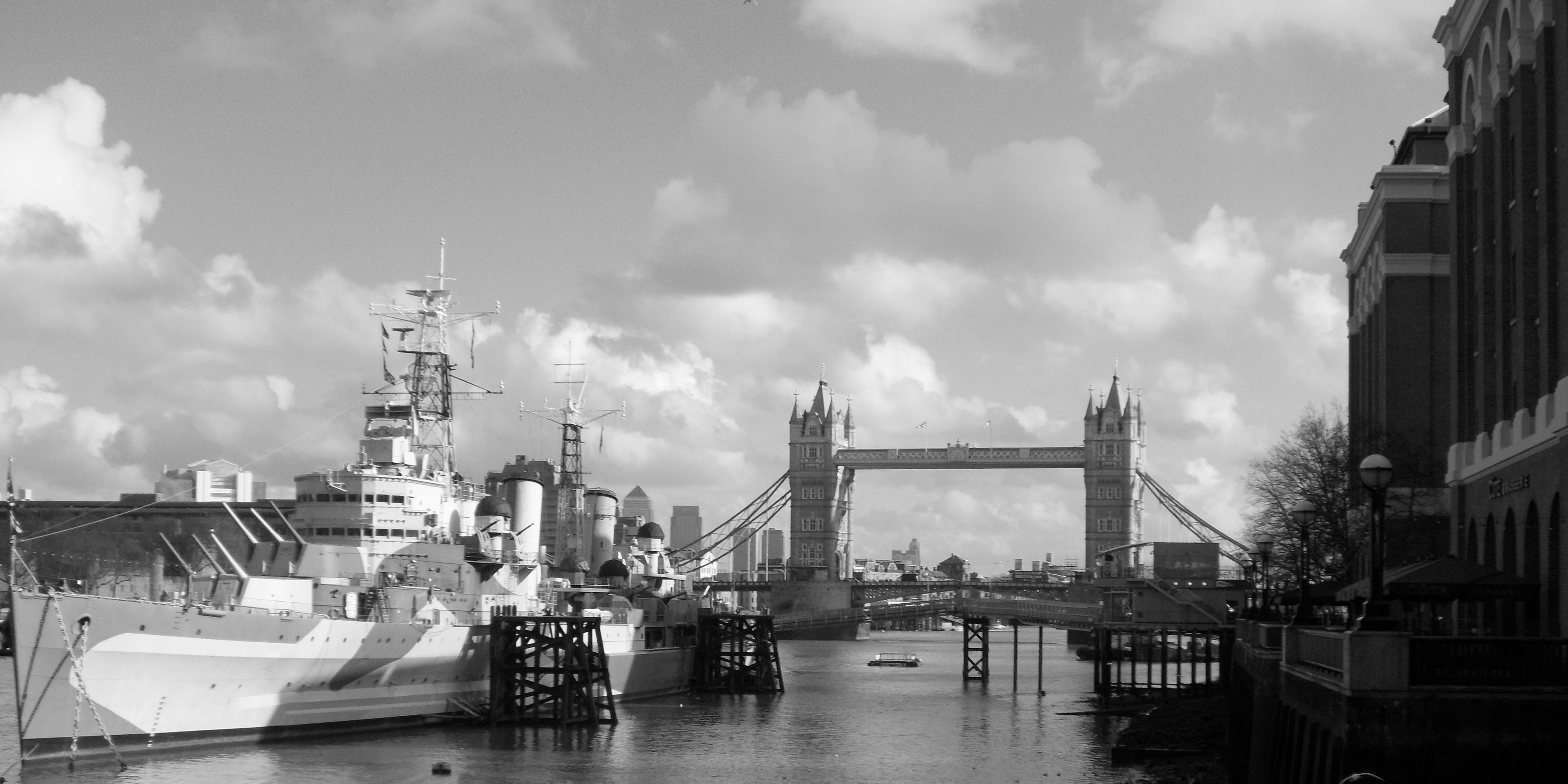 H.M.S Belfast and Tower Bridge and clouds