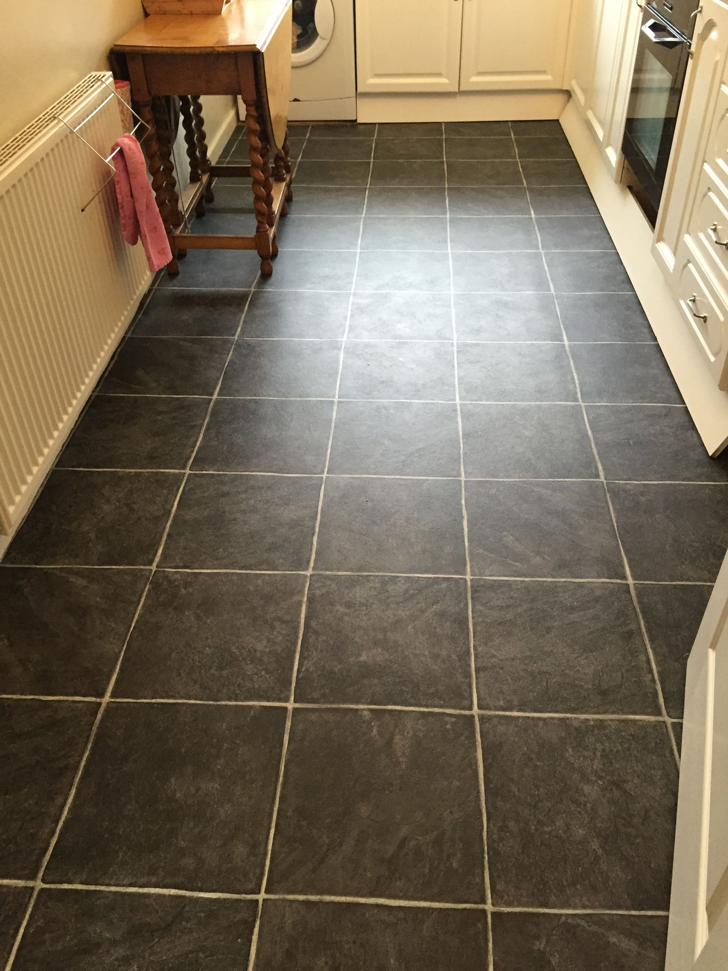Black tile effect vinyl flooring fitted into a kitchen in stockport black tile effect vinyl flooring fitted into a kitchen in stockport cheshire dailygadgetfo Image collections