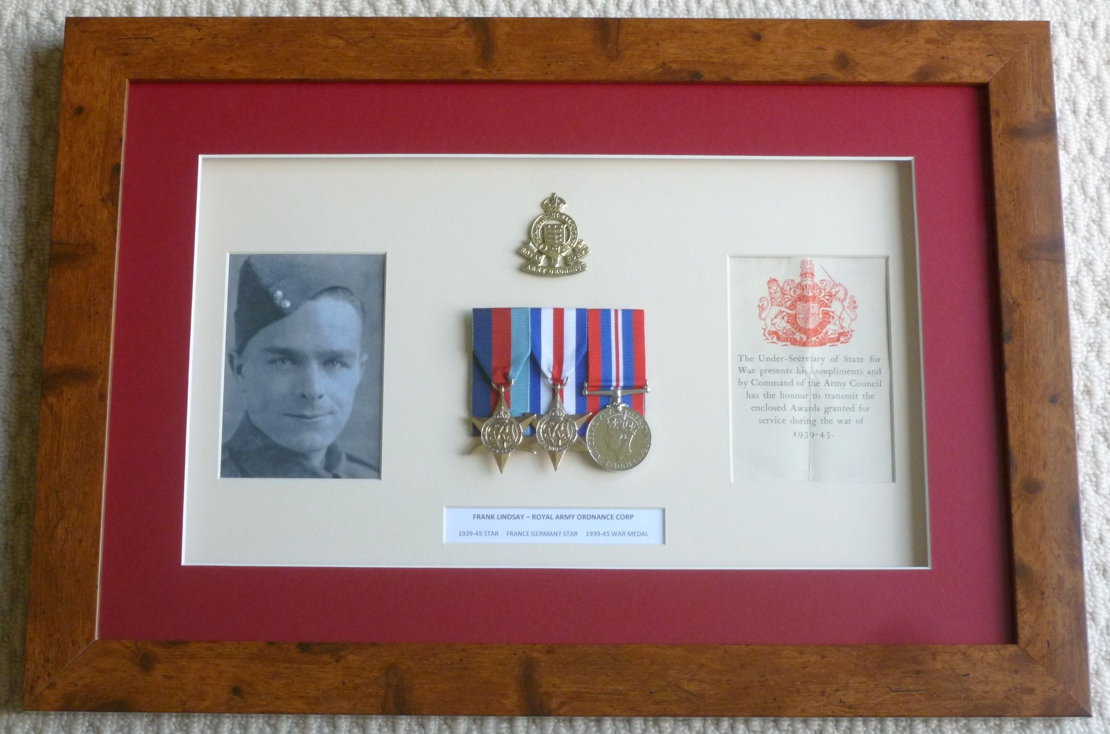 WW2 memorabilia picture frame containing containing 39/45 Star Medal ...