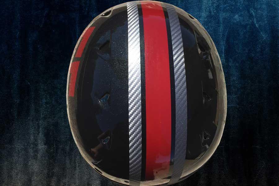 Custom painted crimson football helmets in brilliant black