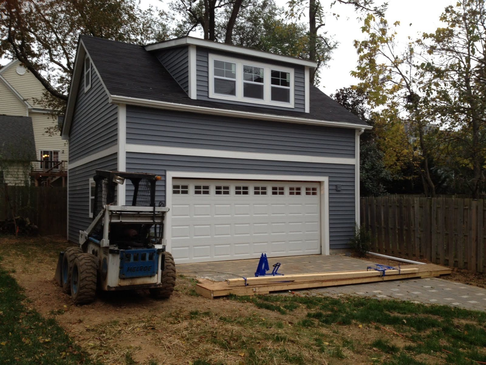 Single shed dormer garage garage conversion dormer for How much does it cost to build a dormer window