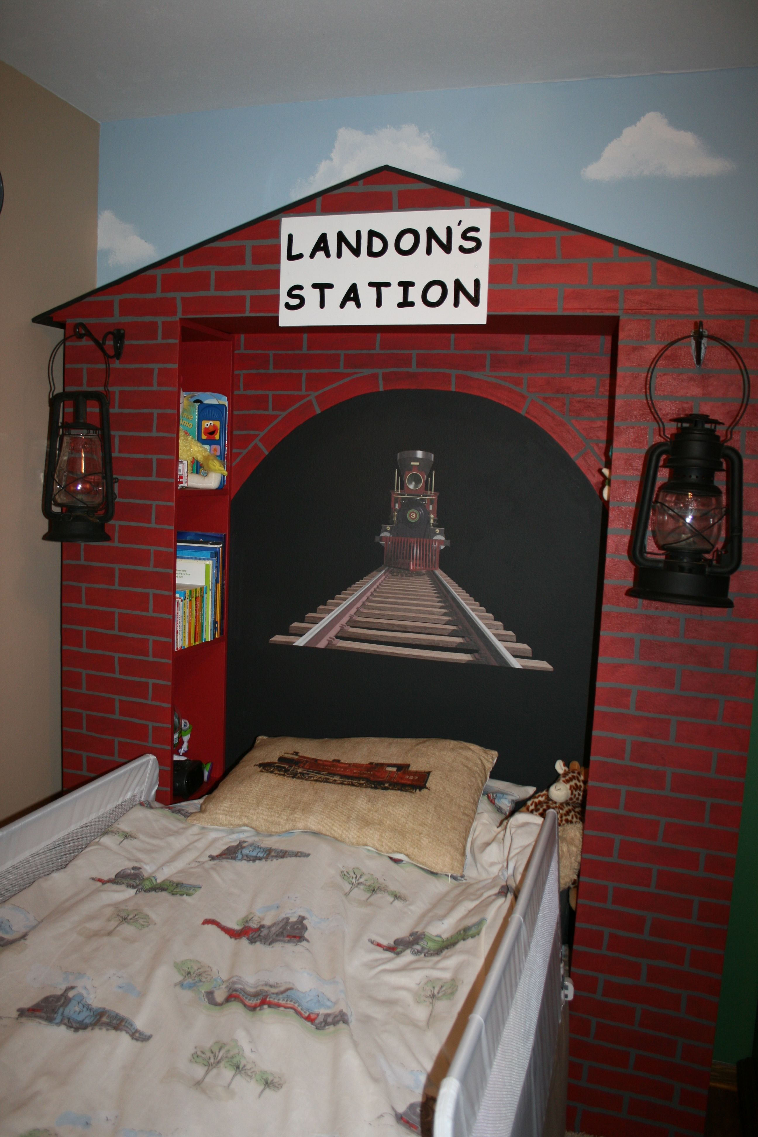 Thomas\'s shed is brown brick with green doors/trim and a black roof ...