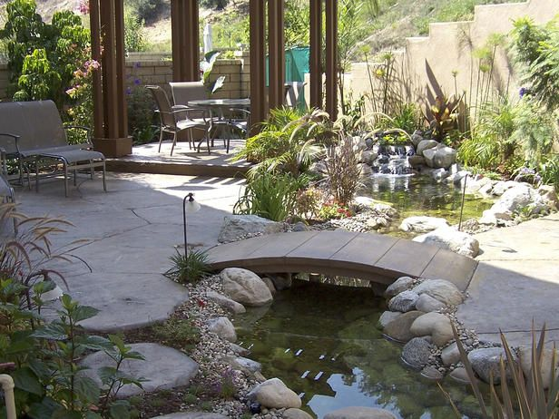 Japanese Pond : A backyard koi pond features a small ...