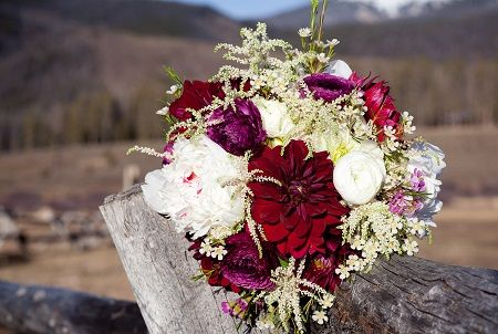 White & Purple bouquet by Statice Floral with dahlias, peonies, ranunculus, astilbe, & waxflower