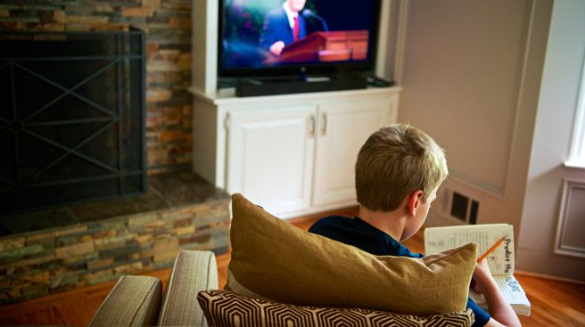 Young man watching General Conference