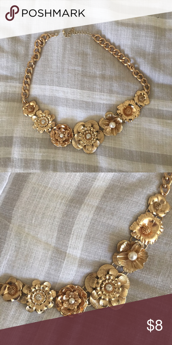 Statement Necklace, Gold Floral Choker This super classy gold statement necklace has an adjustable length. At longest, it can be 19 inches. It lays close to the neck. Floral fixtures have pearl and rhinestone accents. Jewelry Necklaces