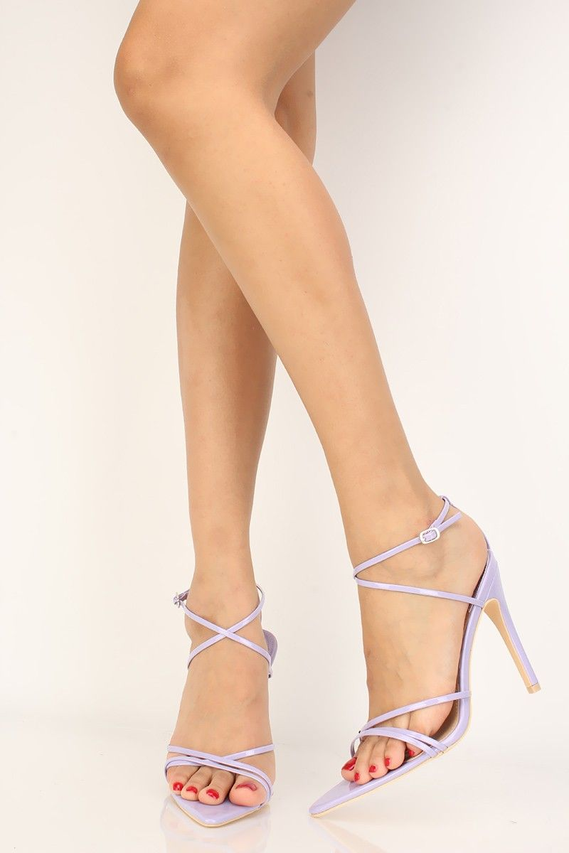 These heels are the perfect statement shoes for the holidays! Featuring   patent