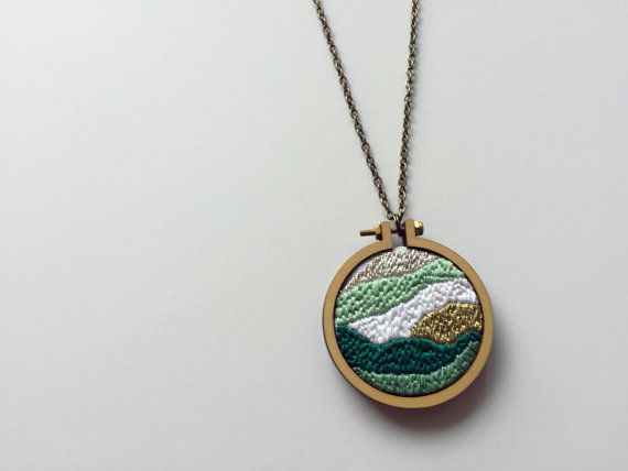 Shades of Jade  This minimalist custom-made hoop necklace features ombre shades of jade green, white, silver and gold thread on a white cotton