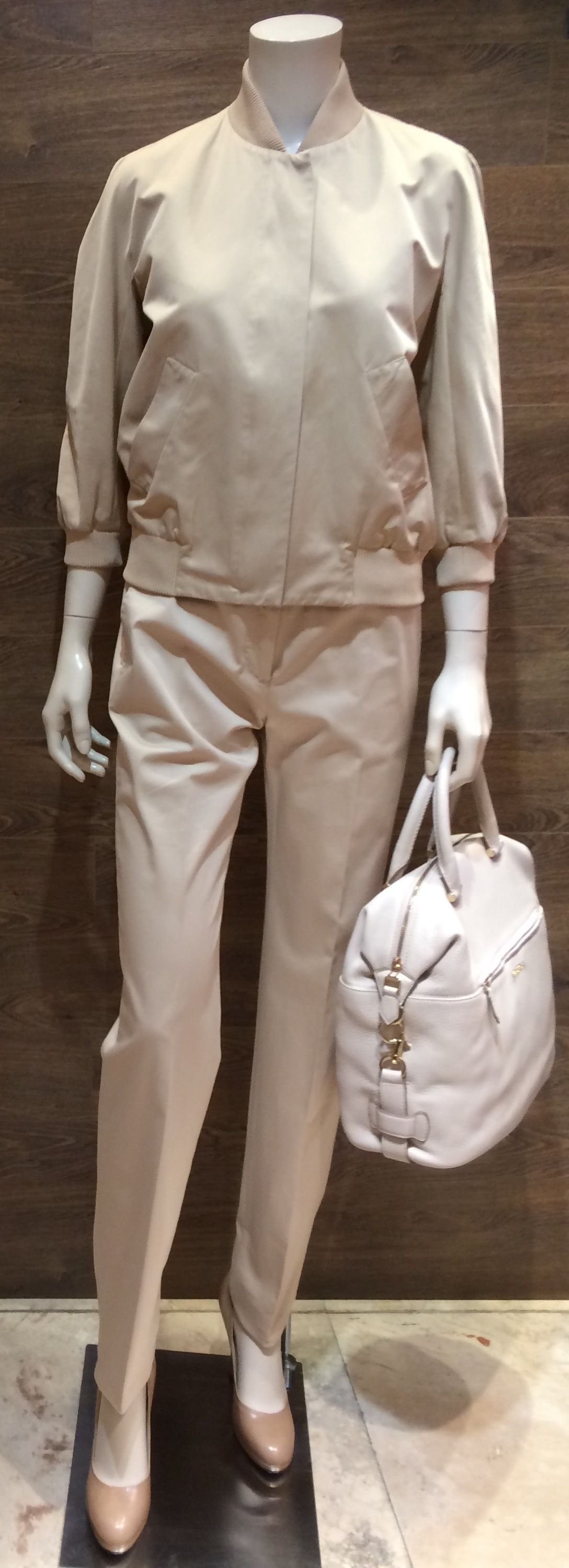 "Always the minimalist, Max Mara presents its less-is-more ideal with an understated beige stretch sateen ¾ sleeve bomber jacket that flaunts a timeless quality | Studio collection beige cotton pants | MaxMara ""Filly"" nude patent leather peep toe heel 
