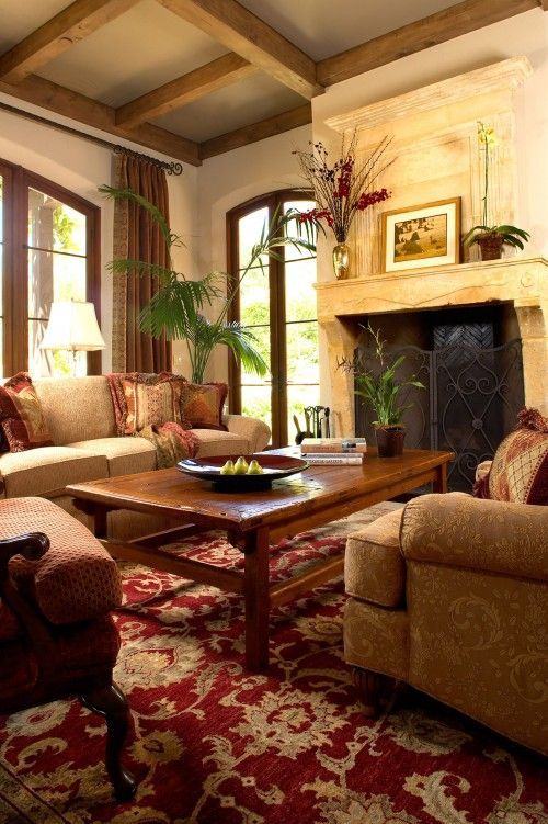 Tuscan Living Room With Stone Fireplace And Note The Awesome Red Carpet Tuscan Living Rooms Colonial Living Room Mediterranean Living Rooms