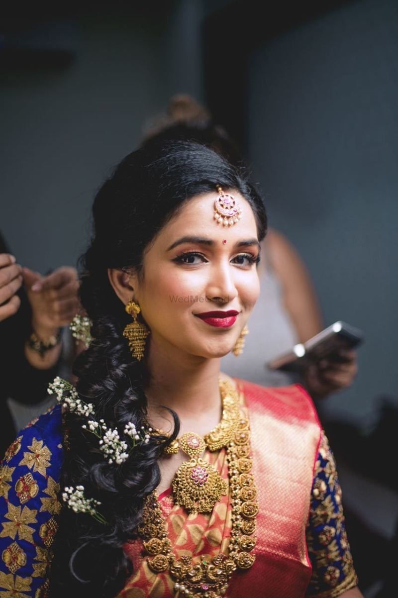 neat bridal braid with flowers for south indian bride