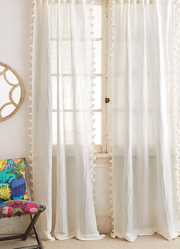 Pom Tassel Nursery Curtain DIY by adding trim to a much cheaper curtain panel - Nursery Curtains