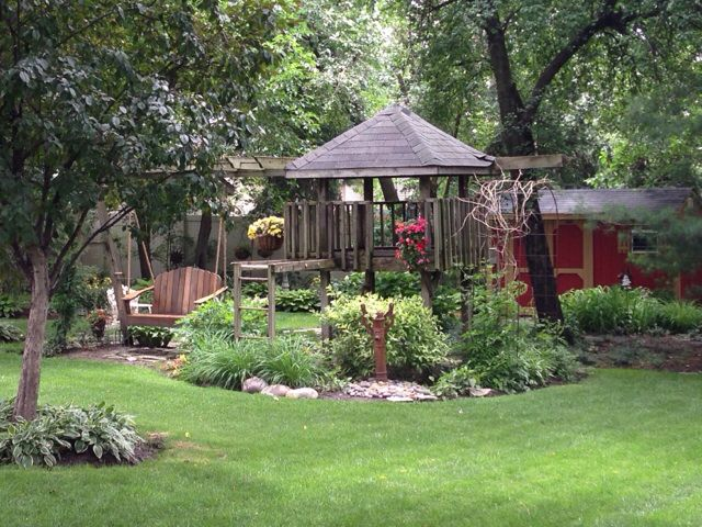 have an old playset? Convert it into a garden sanctuary. Remove the slides add a bench swing. Perennials and viola! #relaxation #garden #playset maybe even a pond