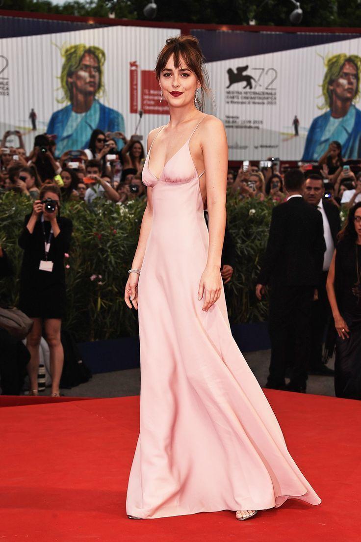 Dakota Johnson in Prada attends the \