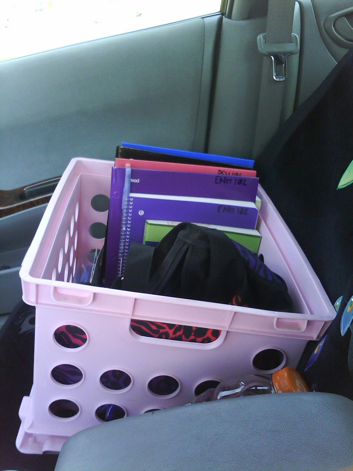 Put a crate in your car to store your books, back pack