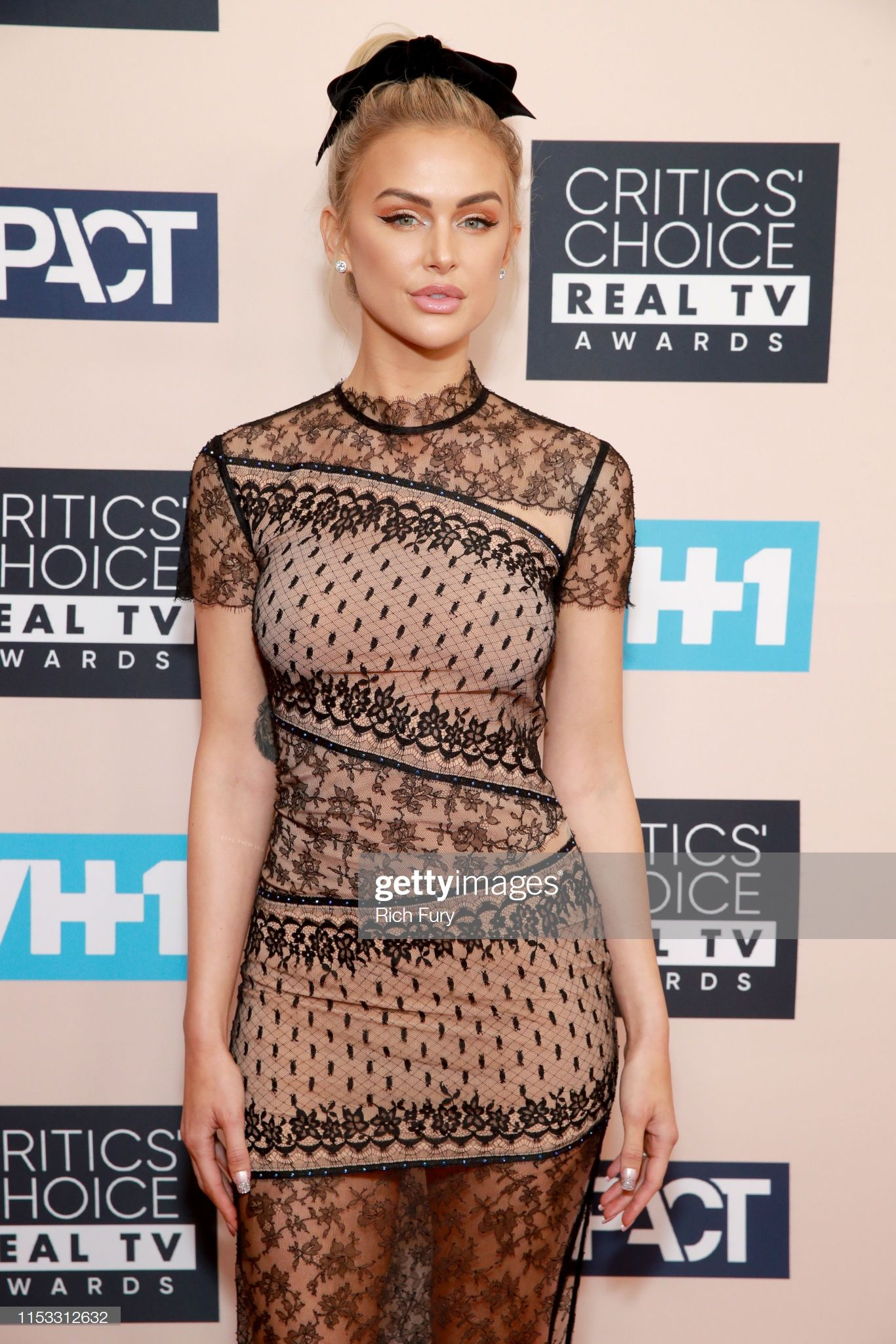 Lala Kent attends Critics Choice Real TV Awards in nude